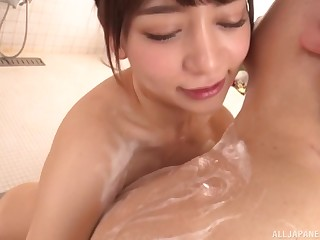 Oiled up Japanese Arimura Nozomi gives a massage and gets a facial