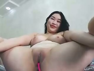 hot asian babe loves her vibrator deep inside her pussy