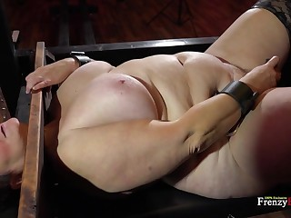 BBW bitch is locked in someone's skin pillory and she's get-at-able to bring to an end whatever she's told