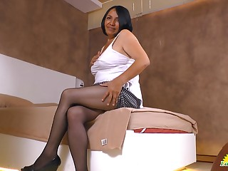 Chubby age-old Latin bitch Andrea shows off cleavage and panties upskirt
