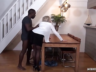Black man is fucking a mature, tow-headed woman, Julie Francais, while her husband is working