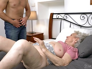Dirty granny Norma B spreads their way legs for their way younger suitor