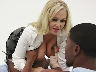 Julia Ann is having steamy sex with a black man, as a representative be incumbent on mode her job