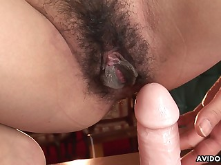 Japanese wife, Yuki Motoyama rides a dildo, uncensored