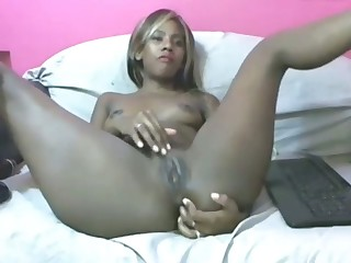 This dark skinned Colombian stunner is fingering her lady holes on cam
