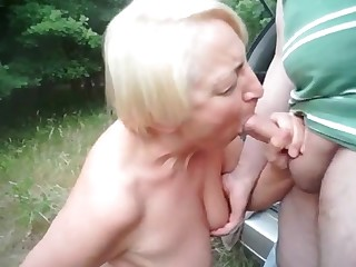 Granny striving after and sucking unknown dick outdoor